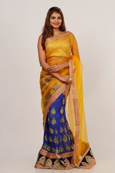 Lehenga by kalanjali #lehenga #blouse #dupatta#Indigo blue brocade over layered net fancy wedding party wear semi stitched lehenga is enhanced with meena-gold embroidered paisley motifs all over, board border add gorgeous charm to this finery. Available matching blouse with bumble yellow shimmer net dupatta.