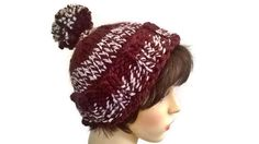 Stay warm this winter with this Fabulous Brown traditional chunky handknitted pom pom hat with no seam. Large bobble. Brown and Cream.  80%