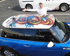 Dave Harris admires the colorful dragon that now lives on the roof of his 2010 MINI Cooper S.