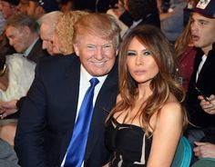 Melania Trump Long Curls - Melania Trump's long brunette locks framed her face as she sat next to her husband, Donald Trump, at the 'Mayweather Vs Pacquiao' show.