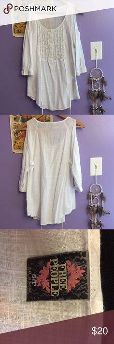 Free People Flowy Top Only worn a handful amount of times. In great condition. Pretty when tired around back. Pretty lace in front Free People Tops