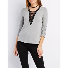Charlotte Russe Lace-Up V-Neck Sweatshirt ($4.99) ❤ liked on Polyvore featuring tops, hoodies, sweatshirts, grey, v-neck tops, plunge lace up top, sexy long sleeve tops, plunge tops and v neck sweatshirt
