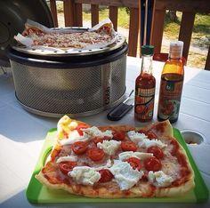 Fresh tomato and mozzarella pizza on the Cobb.
