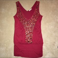 Red blouson sequin tank top by ire EUC Make getting fancy easy with this gold-sequined bold red tank top by ire. The blouson fit and deep v-neck make this soft tank great for when you want to go sexy, without going skintight. Worn once, like new condition. Open to offers & bundle discounts! ☮❤️✌️ ire Tops Tank Tops