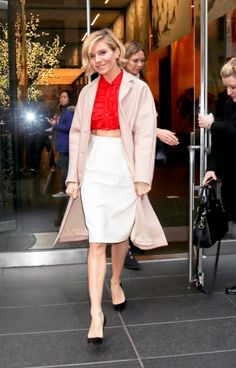 red top belted over white dress + trench + black heels