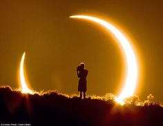 A beautiful solar eclipse watched by a boy.