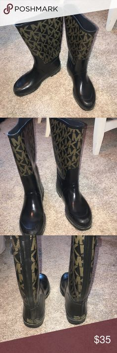 Michael Kors Tall rainboots Michael Kors tall rainboots. They have your typical rainboot wear to them but so cute. Small tear in the right boot on the back but does not go all the way through. Michael Kors Shoes Winter & Rain Boots