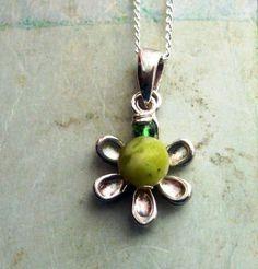 Connemara marble, Sterling silver flower pendant. Bláithín by HandmadebyAmor on…