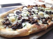 At Olives (NYC) one of Olives wonderful flatbreads, like the wild mushroom one($14) with fontina cheese and caramelized onions