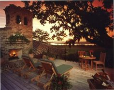 This dramatic deck offers Mediterranean style and a luscious view of water through a beautiful, mature tree.