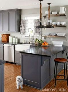 gray kitchen cabinets image via Traditional Home