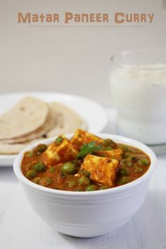 Matar Paneer or mutter paneer recipe with step by step photos - Paneer pieces and green peas are simmered in spicy onion-tomato gravy.