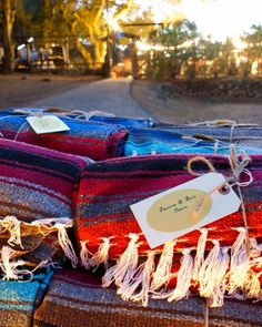 """Mexican blankets wrapped with a tag that read """"I'm yours"""" were given as favors to keep guests warm during the weekend and beyond. """"I regularly see the blankets on beds, as rugs, and over animals on my friends' Instagram feeds,"""" said Naya."""