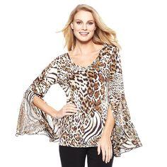 Patrones para confeccionar una blusa con manga de bell o sino. Tallas desde la 36 hasta la 56.