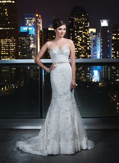 GORG! Justin Alexander signature wedding dresses style 9720 A luxurious beaded sweetheart neckline and beaded trim at the natural  waistline accent this layered lace fit and flare. Satin and beaded  buttons cover the back zipper and continue to the end of the chapel  length train.