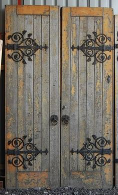 I love these doors for bedroom loft. Love the decorative hinges. Love the door pull handles. Beautiful vintage rustic double doors.