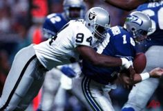 In this Oct. 18, 1992, file photo, Los Angeles Raiders' Anthony Smith (94) sacks Seattle Seahawks quarterback Stan Gelbaugh during the second quarter of an NFL football game in Seattle. Smith, a former defensive end with the Oakland and Los Angeles Raiders, has been found guilty Thursday, Nov. 5, 2015, in the shooting deaths of two brothers in 1999 and the stabbing death of another man in 2001. Prosecutors say all three had been kidnapped and tortured. His attorney, Michael Evans, says…