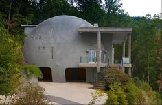 Monolithic modern in Asheville, N.High up in the Blue Ridge Mountains sits a house called Cloud Hidden. The monolithic dome home has more than square feet of living space and is built to withstand fire, hurricanes and tornadoes. Round Building, Green Building, Building A House, Natural Building, Monolithic Dome Homes, Geodesic Dome Homes, Unique Buildings, Beautiful Buildings, Bubble House