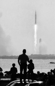 Father and son observe Apollo 11 launch; photograph by Ralph Crane