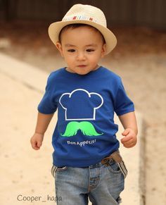"What a cutie! Petit Cooper is rocking our #MÔMES ""Jacques"" tee in royal blue!! The cutest little chef @cooper_hapa 