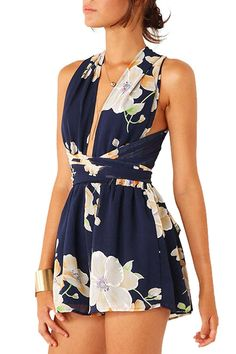 This playsuit features deep plunge neckline with criss crossed back and trying tied-waist at back.The attached shorts offer a comfortable fit. Floral print throughout increases summer energy and brings cool feeling. Simply add white ankle strap heels to lift