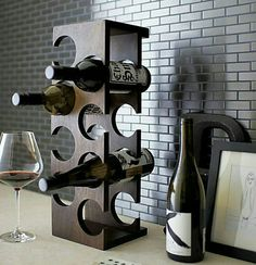 Brandy and Wine. Looking To Enjoy Your Wine More? Are you seeking greater knowledge about wine? Perhaps you would like to wow one of your friends with your knowledge. Wine Rack Design, Home Bar Accessories, Rustic Wine Racks, Modern Wine Rack, Modern Bar, Wine Shelves, Wine Storage, Kitchen Storage, Bois Diy