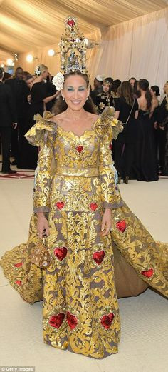 Goddess: Sarah Jessica Parker wowed in her gold and copper look, which included large red ...