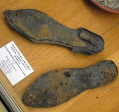 Second century leather shoes from the site of Martres de Veyre. The sole consists of several layers of leather held together with iron nails. Discovered during 1893.