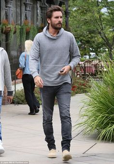 Out and about: Scott Disick sported a grey hoodie and black jeans as he stepped out in Calabasas on Wednesday