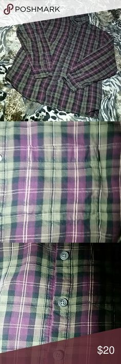 Plaid Flannel Plaid Flannel, not sure of the brand or size but fits like an oversized small or a size medium ! EUC better ! Purple, Green & Black colors .. Superr cute, extra comfy & looks great on. Perfect with leggings or jeans .. Received from another posher, but unfortunately don't like the way it looks on me 😢👎 So I am re-poshing .. My loss, your gain 😄👍  CROSS-POSTED !!!!  💞Trades are welcomed, but would prefer to sell..💞 Tops Button Down Shirts