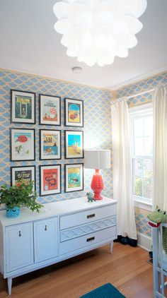 Framed vintage Tintin book covers make this wall especially adorable. Modern furnishings make it picture perfect.    Image: freshquince.blogspot.com, via Pinterest
