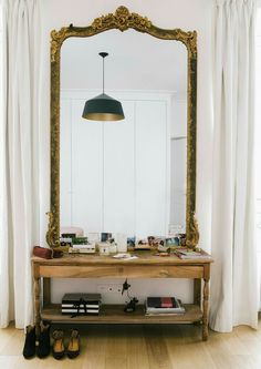 coffee table with mirror above