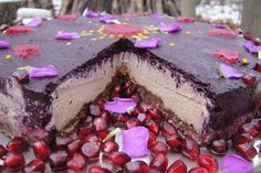 raw food cake with fruit, nuts, coconut, flowers, sweets, spices and love