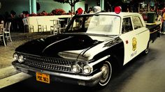 Police brutality!   1961 Ford Galaxie at Singapore Universal Studios