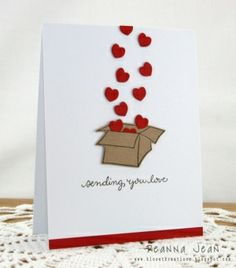 To have the hearts look like they are coming out of the top of the box, cut a slit in the top of it. This allows you to tuck the first couple of hearts inside. by anastasia