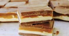 Satisfy your sweet tooth with these deliciously easy no-bake slices. From better-for-you muesli slice to more indulgent Mars Bar slice, there's a slice to suit any taste. - A recipe collection from… Gluten Free Icing, Snickers Dessert, Muesli Slice, Oat Slice, No Bake Desserts, Dessert Recipes, Bar Recipes, No Bake Slices, Clotted Cream