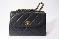 Vintage Rare CHANEL Large Black Classic Flap Bag with Gold CC Closure.  at Rice and Beans Vintage http://www.riceandbeansvintage.com