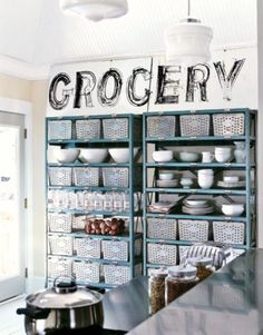 industrial Shelving.  Could do a mini version of dry storage on top of the fridge.