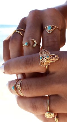Boho jewelry style...love that elephant ring.
