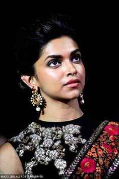 Deepika Padukone in saree and high neck blouse