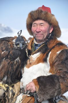 Kazakh Eagle Hunter. Kazakh people living in Mongolia near Bayan-Olgii use golden eagles to hunt wild sheep, foxes and wolves, and get together once a year in October to show off and compete.