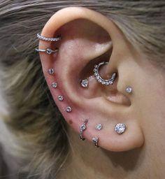 Multiple piercings, delicate diamond earrings