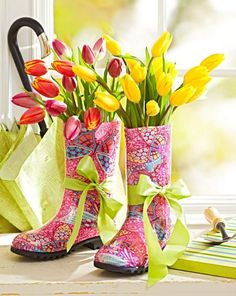Fill colorful rain boots with coordinating colors of tulips or other spring flowers. Use florist water tubes to keep the flowers fresh. Tie on a pretty ribbon for the finishing touch.