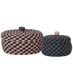 Ferm LIVING Braided Baskets is a set of Gorgeous round braided baskets crafted by hand making each one stand out. Pretty two tone colour way of rose pink and blue with black and alternate colour braided bobble tops. Durable and pretty made from pape