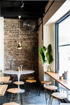 Harrys Bar and Dining, Bondi Beach, Sydney. Black and timber Tuckbox Design Klein/Gem stools in a beachside restaurant