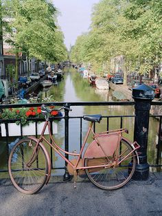 A bicycle,a bridge and a canal in Amsterdam, Netherlands. Quintessentially Dutch!
