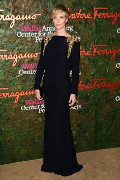 Charlize Theron wore an Alexander McQueen gown from the pre-autumn/winter 2013 collection and carried a Ferragamo clutch.
