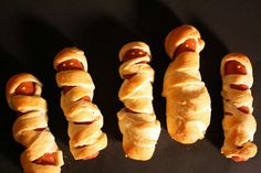 """""""mummy dogs"""".  Hot dog wrapped in crecent rolls cut into strips. CUTE (mustard as the eyes)"""