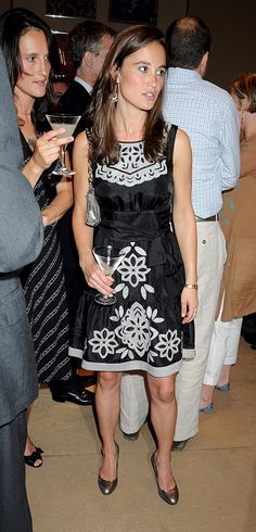 Pippa wore this black and white belted dress to a book launch party. via @AOL_Lifestyle Read more: http://www.aol.com/article/2014/09/06/pippa-middletons-style-transformation/20713066/?a_dgi=aolshare_pinterest#fullscreen