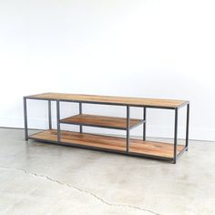 Simple form, rustic wood, and an industrial hand welded frame. Our reclaimed wood storage media console functionally offers room for your tv & devices and space to display your personal accents. Made with authentic reclaimed elm wood and finished with an eco-friendly, voc-free finish, you can be assured that you not only are being green by using reclaimed barn wood, you are also not bringing any toxins into your home!